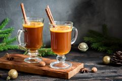 Hot buttered rum. Cocktail with cinnamon for Christmas and winter holidays. Homemade festive hot Christmas drink Royalty Free Stock Images