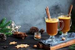 Hot buttered rum. Cocktail with cinnamon for Christmas and winter holidays. Homemade festive hot Christmas drink stock photo