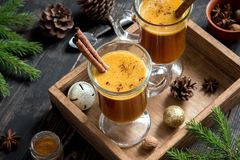 Hot buttered rum. Cocktail with cinnamon for Christmas and winter holidays. Homemade festive hot Christmas drink Stock Photography