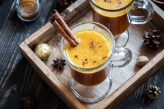 Hot buttered rum. Cocktail with cinnamon for Christmas and winter holidays. Homemade festive hot Christmas drink Stock Images