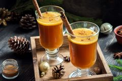Hot buttered rum. Cocktail with cinnamon for Christmas and winter holidays. Homemade festive hot Christmas drink Stock Image