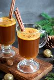 Hot buttered rum. Cocktail with cinnamon for Christmas and winter holidays. Homemade festive hot Christmas drink Royalty Free Stock Photo