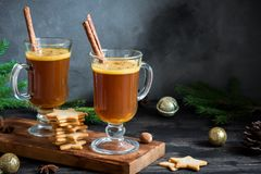 Hot buttered rum. Cocktail with cinnamon for Christmas and winter holidays. Homemade festive hot Christmas drink Royalty Free Stock Photography