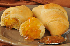 Hot buttery croissants orange marmalade Royalty Free Stock Photo