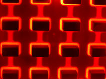HOT BUTTONS! (Abstract). Red backlight makes these buttons HOT! Focus on panel with top of buttons DOF blurred gives a heat shimmer look stock photography