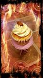 Hot Cake. Almond buttercream cupcake with fire frame stock photos