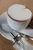 Hot cappuccino. With sugar and cookies Royalty Free Stock Photography