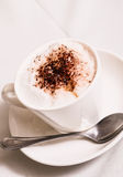 Hot cappuccino in a cafe. Hot cappuccino served in a cafe Royalty Free Stock Image