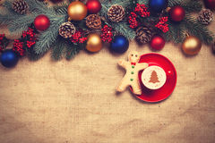 Hot cappuccino with christmas tree shape Royalty Free Stock Photos