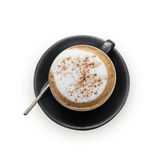 Hot cappuccino coffee cup on grass table with stone background Royalty Free Stock Photography