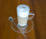 Hot cappuccino Coffee with tall glass on wood table Royalty Free Stock Photo