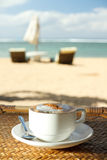 Hot cappuccino coffee at tropical beach Royalty Free Stock Photography