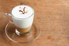Hot Cappuccino Coffee on Wooden Table Stock Photo