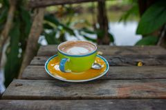 Hot Cappuccino in the cup. On wood table Royalty Free Stock Photos