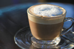 Hot cappuccino in the morning. Hot cappuccino for in the morning Royalty Free Stock Photography