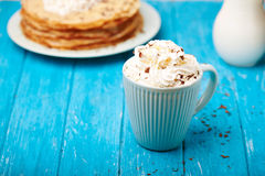 Hot cappuccino and pancakes Royalty Free Stock Photography