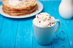 Hot cappuccino and pancakes Royalty Free Stock Photos