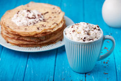 Hot cappuccino and pancakes Royalty Free Stock Images