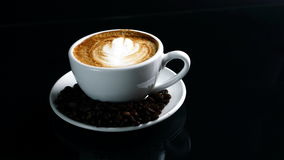 Hot cappuccino with streamed milk royalty free stock image