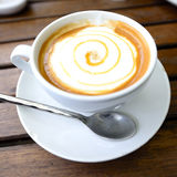 The Hot Cappuccino top in white cup Royalty Free Stock Images