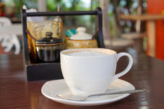 Hot cappuccino in white cup Royalty Free Stock Photo