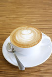 Hot Cappuccino with white cup Royalty Free Stock Image