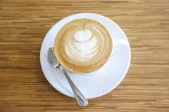 Hot Cappuccino with white cup Stock Photos