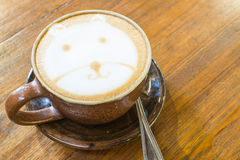 Hot Cappuccino on wooden background Stock Photo