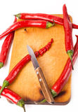 Hot capsicum chili pepper and knife on board Royalty Free Stock Photo