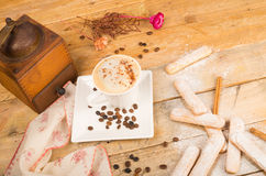 Hot capuccino and biscuits Stock Images