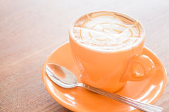 Hot caramel coffee latte cup Stock Images