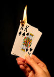 Hot Card Hand (Focus at bottom of flame) Stock Photography