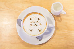 Hot cat latte coffee. Hot coffee on the table / Hot cat coffee latte Royalty Free Stock Images