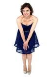 Hot caucasian female in corset, bending down Royalty Free Stock Image