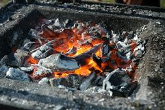 Hot Charcoal. A closeup of glowing hot charcoal in an open grill oven stock image