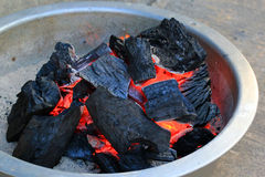 Hot charcoal in bowl Royalty Free Stock Image