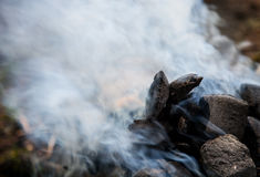 Hot charcoal with a dense smoke Royalty Free Stock Photo