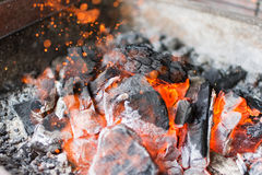 Hot Charcoal Glowing Briquettes. Burning Charcoal Close Up. Stock Photo