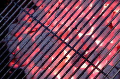 Hot charcoal grill. Grate on charcoal grill with flames Royalty Free Stock Photo