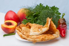 Hot cheburek with vegetables and fruits Royalty Free Stock Photography