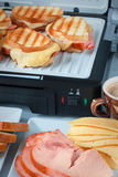 Hot cheese and ham sandwiches, cup of coffee  slices Royalty Free Stock Photos