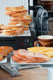 Hot cheese and ham sandwiches, a  slicer, cup of coffee slices Stock Photography