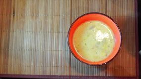 Hot cheese soup with chicken broth with herbs stock video footage