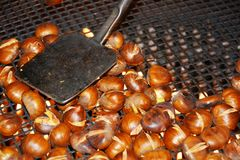 Hot chestnuts in pot, food background Stock Image