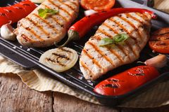 Hot chicken with peppers and tomatoes in a skillet grill Stock Image