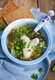 Hot chicken and sorrel soup with herbs Royalty Free Stock Images