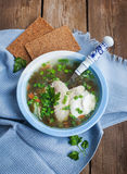 Hot chicken and sorrel soup Stock Photos