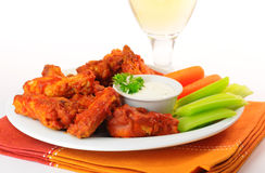 Hot Chicken Wings. Hot and spicy buffalo chicken wings and crisp vegetables Royalty Free Stock Image