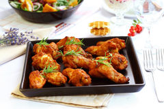 Hot chicken wings. On baking tray royalty free stock photography
