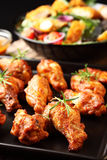 Hot chicken wings. On baking tray Stock Photos